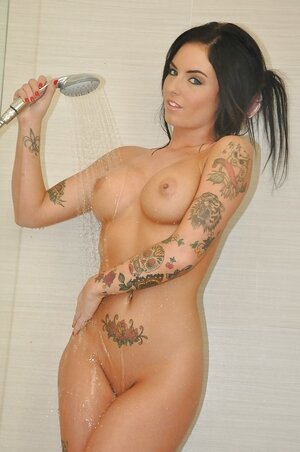 Tattooed brunette Christy Mack with big tits and ass in the shower stall