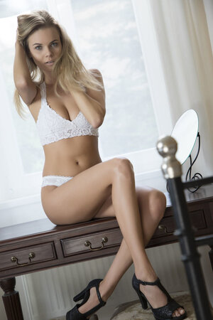 Topnotch model takes off beautiful white bra first and then matching panties
