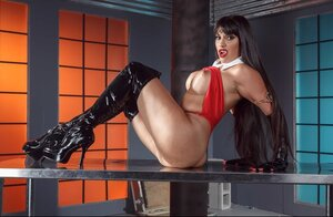 Filthified adult video star in black leather high boots and also gloves flashes her twins