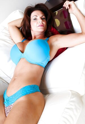 Aged goddess poses in blue underwear that accentuates her amazing assets
