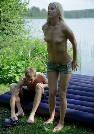 Russian blonde has sex with boyfriend not far away from the lake and moreover swallows