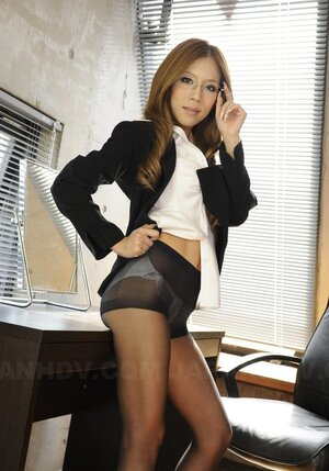 Teenage sexy asian office girl shows underwear she is wearing at work