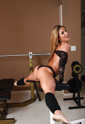 Fabulous MILF with flexible tanned body and amazing ass in black underwear at workout