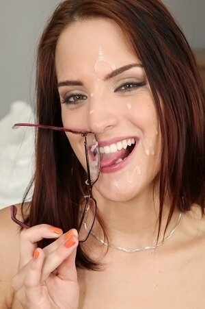 Redhead takes glasses off and puts it on before lover cums on her face