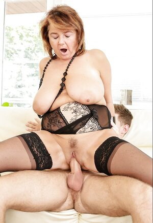 Grown-up dame with heavy melons in hot stockings fucked by less aged fella
