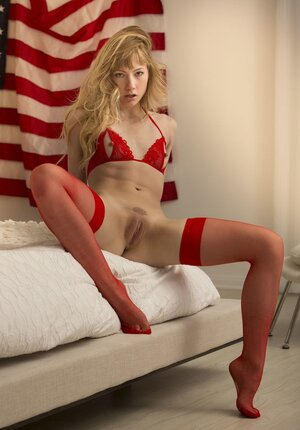 18-19 y.o. in red underwear flashes her body in the background of the Northern american flag