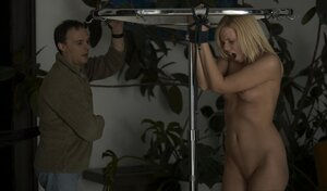 Blonde gal with pinioned up hands needs to give blowjob if she wants to be free
