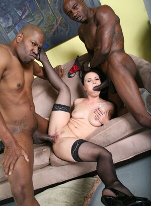Seducing pale-skinned floozy enjoys black flag poles in pussy and asshole at once