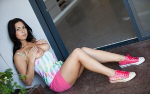 Wooden floor is extremely comfortable for brunette dame to flash natural jugs