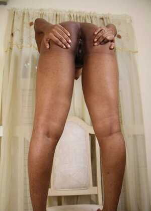Ebony bitch with playful eyes first takes bra off and then purple panties