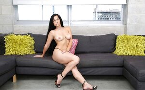 Long-haired chick with natural titties and sexy legs poses in solitary gallery