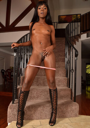 Chocolate girl in high leather boots spreads her petite ass and cum bucket